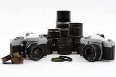Old photo cameras with lenses Royalty Free Stock Photo