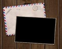 Old photo and envelope. Old photo and envelope on wooden table vector illustration