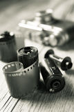 Old photo film rolls, cassette and retro camera Royalty Free Stock Images