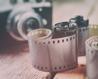Old photo film rolls, cassette and retro camera. On background. Vintage styled Stock Images