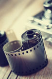 Old photo film rolls, cassette and retro camera on background. Royalty Free Stock Photo