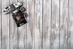Old photo film rolls, cassette and retro camera on background. Vintage stylized royalty free stock photography