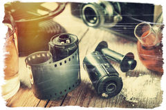 Old photo film rolls, cassette, retro camera and chemical reagen. Ts for photographic film. Vintage stylized Stock Photo