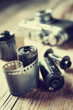 Old photo film rolls, cassette and retro camera. Royalty Free Stock Photo