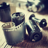 Old photo film rolls, cassette and retro camera. Royalty Free Stock Image