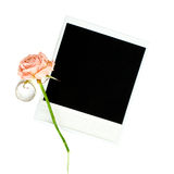 Old photo frame with love rind and rose. Isolated stock photography