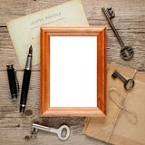 Old photo frame on wood Stock Photography
