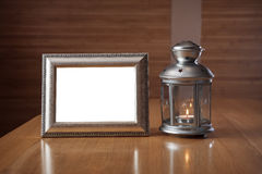Old photo frame on the wooden table Stock Photos