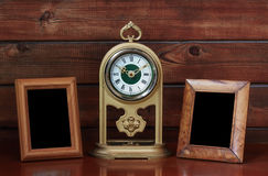 Old photo frames and antique clock Stock Photos