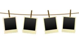 Old photo frames on a clothesline Stock Photos