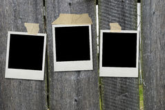 Old photo frames on fence Royalty Free Stock Photography