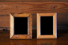 Old photo frames on table Royalty Free Stock Photo