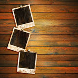 Old photo frames on wood Stock Image