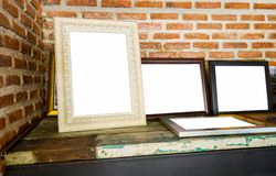 Old photo frames on the wooden table Royalty Free Stock Image