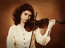 Old photo of a girl playing violin Royalty Free Stock Image