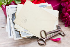 Old photo and key ona table Royalty Free Stock Images