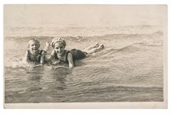Old photo kids on the sea Vintage picture. Old photo of kids on the sea. Vintage picture with original film grain and blur royalty free stock images