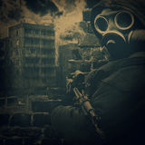 Old photo of man in gas mask. With gun in his hand royalty free stock photos
