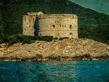 Old photo with a medieval fortress on the coast of Dalmatia Stock Photos