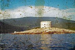 Old photo with a medieval fortress on the coast of Dalmatia 2 Stock Images