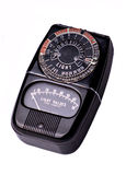 Old Photo Meter. A vintage photographic light meter isolated on white royalty free stock photos