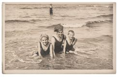 Old photo mother children on the sea Vintage picture. Old photo of mother and children on the sea. Vintage picture with original film grain and blur from 1921 Royalty Free Stock Photo