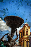 Old photo with old bronze statue and german church Royalty Free Stock Photo