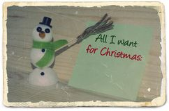 Old photo paper with message All I want for Christmas Stock Images