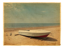 Old photo of Sea boat at beach Royalty Free Stock Photography