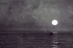 Old photo of sea landscape. Old scratchy photo of sea landscape with lonely boat Stock Image