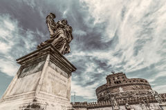 Old photo with statue of Angel from Angels Bridge and castle San Royalty Free Stock Photo