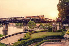 Old photo style Bridge over the River Kwai. Grunge old photo vintage style, trains running on the bridge over the River Kwai is a historical attractions during Royalty Free Stock Photo