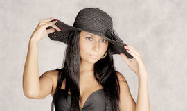 Old photo  stylization young women in hat Stock Photo