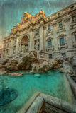 Old photo with Trevi Fountain. The baroque fountain in Rome, Italy, at dusk. Vintage processing Royalty Free Stock Photography