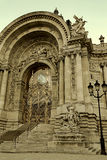 Old photo with view at Petit Palais entrance in Paris Royalty Free Stock Photography