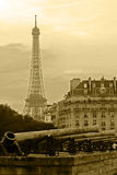 Old photo with vintage cannons and Eiffel tower Royalty Free Stock Image