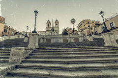 Old photo in vintage style with Spanish Steps from Piazza di Spa Royalty Free Stock Image