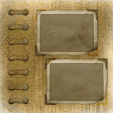Old photoalbum with two grunge frames Royalty Free Stock Photo