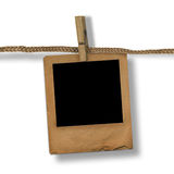 Old photoframe are hanging in the row Royalty Free Stock Photos