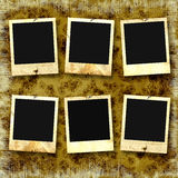 Old photoframes. Are hanging on the vintage background Royalty Free Stock Photos