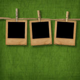 Old photoframes are hanging in the row Stock Photography