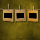 Old photoframes are hanging in the row Stock Photos