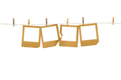 Old photoframes are hanging in the row Stock Images