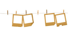 Old photoframes are hanging in the row Stock Image