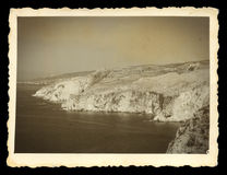 Steep sea cliffs vintage photo Stock Images