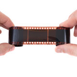 Old photographic film in the hands Stock Images