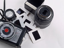 Old photography gear. Consisting ofLight meter, loupe, slides, lens Royalty Free Stock Image