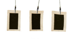 Old photos. Three hanging old photos over the white royalty free stock photos