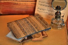 Old photos and album on beige background Royalty Free Stock Images