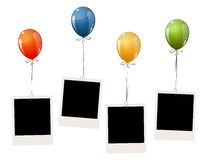 Old photos with balloons. Four old empty photos hanging on flying colored balloons Royalty Free Stock Photos